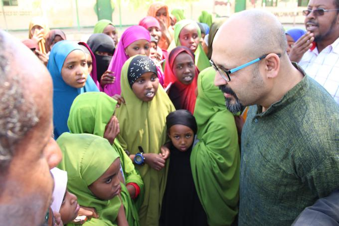 Save the Children International Programmes Director, Imran Matin, in conversation with a group of girls in Borama primary school in Somaliland during his last visit to Somaliland/Somalia. Photo Mowlid Mudan | Save the Children